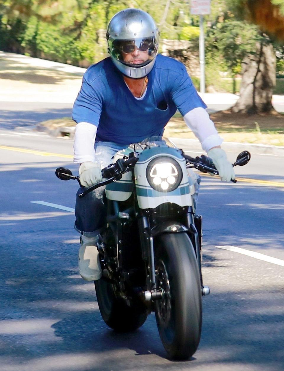 <p>Brad Pitt is seen leaving ex Angelina Jolie's home on his motorcycle after a visit with their kids on Tuesday in Los Angeles. </p>