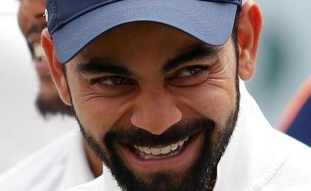 Cricket - India v Australia - Fourth Test cricket match - Himachal Pradesh Cricket Association Stadium, Dharamsala, India - 28/03/17 - India's Virat Kohli laughs during an award ceremony after winning the series. REUTERS/Adnan Abidi