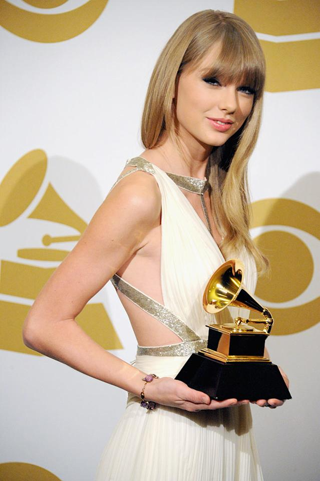 Taylor Swift poses in the press room during the 55th Annual GRAMMY Awards at STAPLES Center on February 10, 2013 in Los Angeles, California.