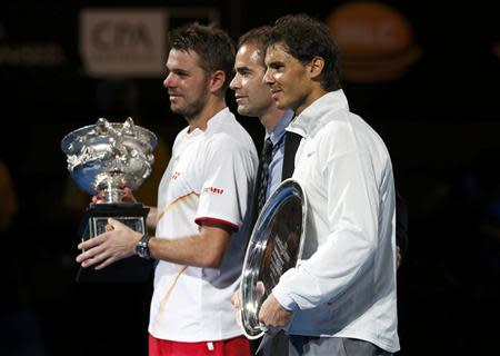 Rafael Nadal of Spain (R), Stanislas Wawrinka of Switzerland and Pete Sampras of the U.S. (C) pose during the prize ceremony after the men's singles final match at the Australian Open 2014 tennis tournament in Melbourne January 26, 2014. REUTERS/Bobby Yip