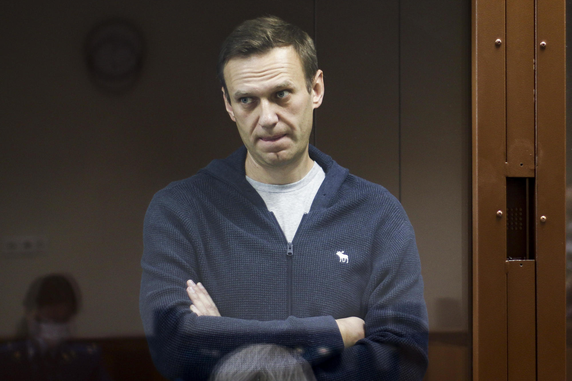 Russia's Navalny moved to prison as Amnesty changes his status