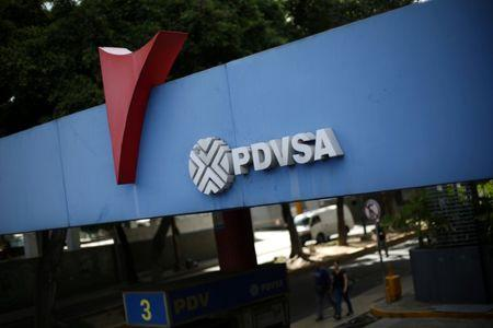 FILE PHOTO: The corporate logo of the state oil company PDVSA is seen at a gas station in Caracas, Venezuela, August 30, 2017. REUTERS/Andres Martinez Casares/File Photo