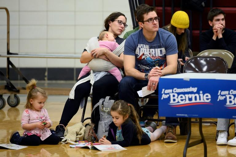 Supporters of Democratic presidential candidate Bernie Sanders wait to be counted in Iowa (AFP Photo/JIM WATSON)