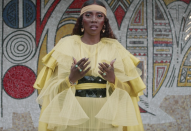 """<p>In """"Keys to the Kingdom,"""" Nigerian singer-songwriter Tiwa Savage wears a beautiful yellow outfit. </p>"""