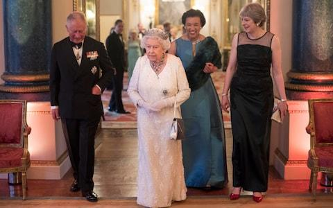 The Prince of Wales, Queen, Baroness Scotland and Theresa May at a Buckingham Palace dinner to celebrate the Commonwealth - Credit: PA