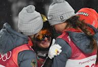 <p>Germany's Katharina Althaus is comforted by fellow compatriots as she reacts to winning the silver medal in the women's normal hill individual ski jumping trial for competition event during the Pyeongchang 2018 Winter Olympic Games on February 12, 2018, in Pyeongchang. / AFP PHOTO / Christof STACHE </p>
