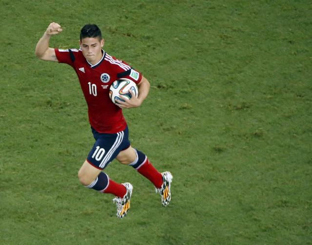 Colombia's James Rodriguez celebrates after scoring a penalty goal against Brazil during their 2014 World Cup quarter-finals at the Castelao arena in Fortaleza July 4, 2014. REUTERS/Fabrizio Bensch (BRAZIL - Tags: SOCCER SPORT WORLD CUP)