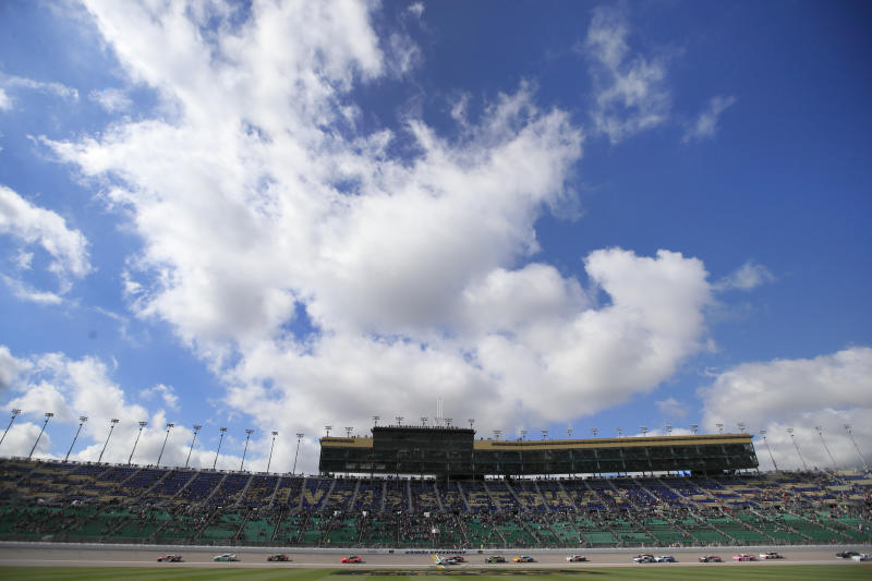 NASCAR Xfinity drivers finish an early lap during a NASCAR Xfinity Series auto race at Kansas Speedway in Kansas City, Kan., Saturday, Oct. 19, 2019. (AP Photo/Orlin Wagner)