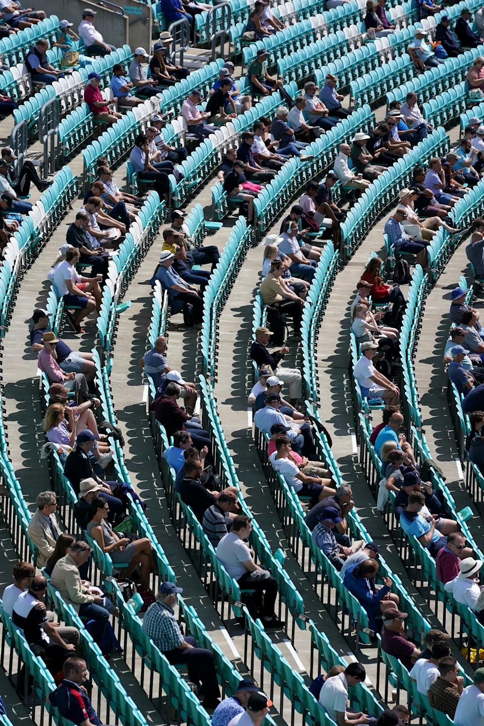 Seats were left empty to keep distance between spectators. (PA)