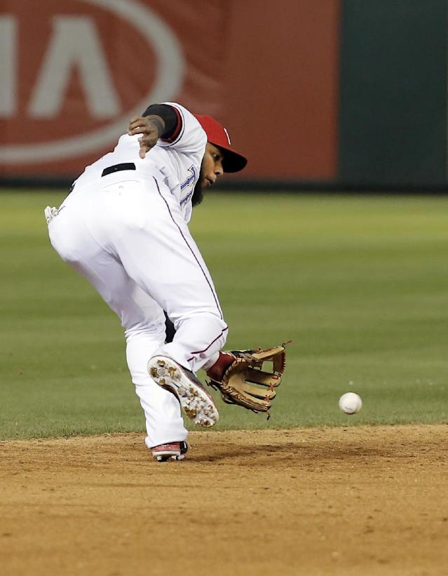 Texas Rangers shortstop Elvis Andrus (1) fields a hit by Seattle Mariners' Mike Zunino during the ninth inning of a baseball game on Wednesday, April 16, 2014, in Arlington, Texas. Andrus then made the throw to first for the out. Texas won 3-2. (AP Photo/Brandon Wade)