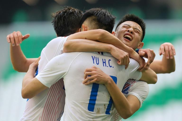 Shenhua's Yu Hanchao (11) celebrates his goal