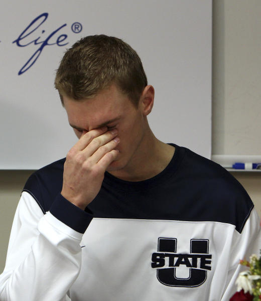 FILE - In this Dec. 7, 2012, file photo, Utah State basketball player Danny Berger becomes emotional as he speaks with reporters about his recovery at Intermountain Medical Center in Murray, Utah. Berger collapsed during NCAA college basketball practice and went into cardiac arrest, resulting in a defibrillator being implanted in his chest. Berger ran a mile the other day then did some stairs afterward, just six weeks after he nearly died after collapsing on the basketball court. (AP Photo/Deseret News, Ravell Call, File)