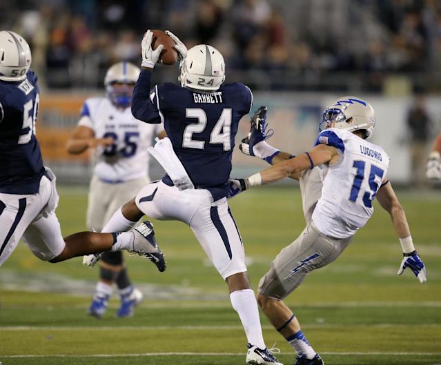 Nevada's Charles Garrett (24) intercepts a pass from Air Force's Karson Roberts (16) during the second half of an NCAA football game in Reno, Nev., on Saturday, Sept. 28, 2013. The interception clinched the win in the final seconds of the game. Nevada won 45-42. (AP Photo/Cathleen Allison)