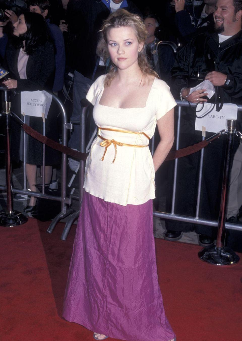 <p>At the premiere of <em>Cruel Intentions</em>, Reese opted for a white shirt with ribbon detailing paired with a magenta skirt for a look that seems right out of a Jane Austen novel. </p>