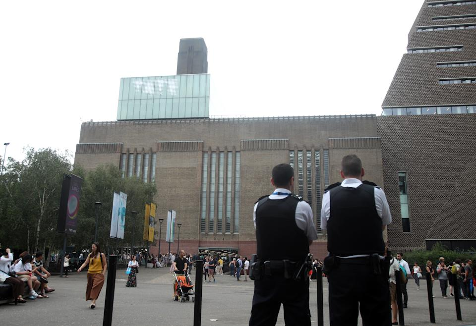 Emergency crews attending a scene at the Tate Modern art gallery, where a teenager has been arrested after a child fell from height and has been taken to hospital from the gallery in central London by air ambulance.
