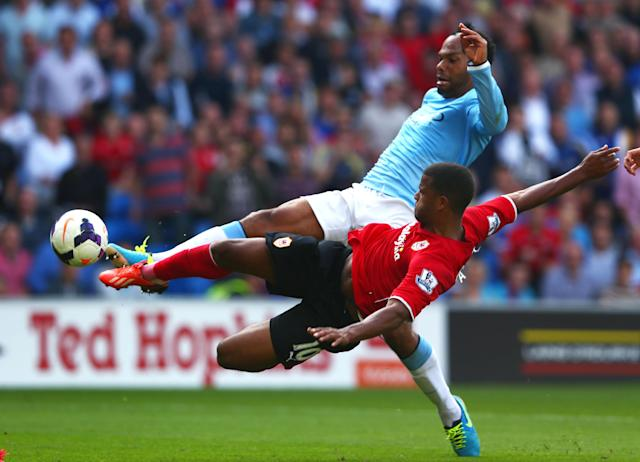 CARDIFF, WALES - AUGUST 25: Fraizer Campbell of Cardiff has his shot on goal blocked by Joleon Lescott of Manchester City during the Barclays Premier League match between Cardiff City and Manchester City at Cardiff City Stadium on August 25, 2013 in Cardiff, Wales. (Photo by Michael Steele/Getty Images)
