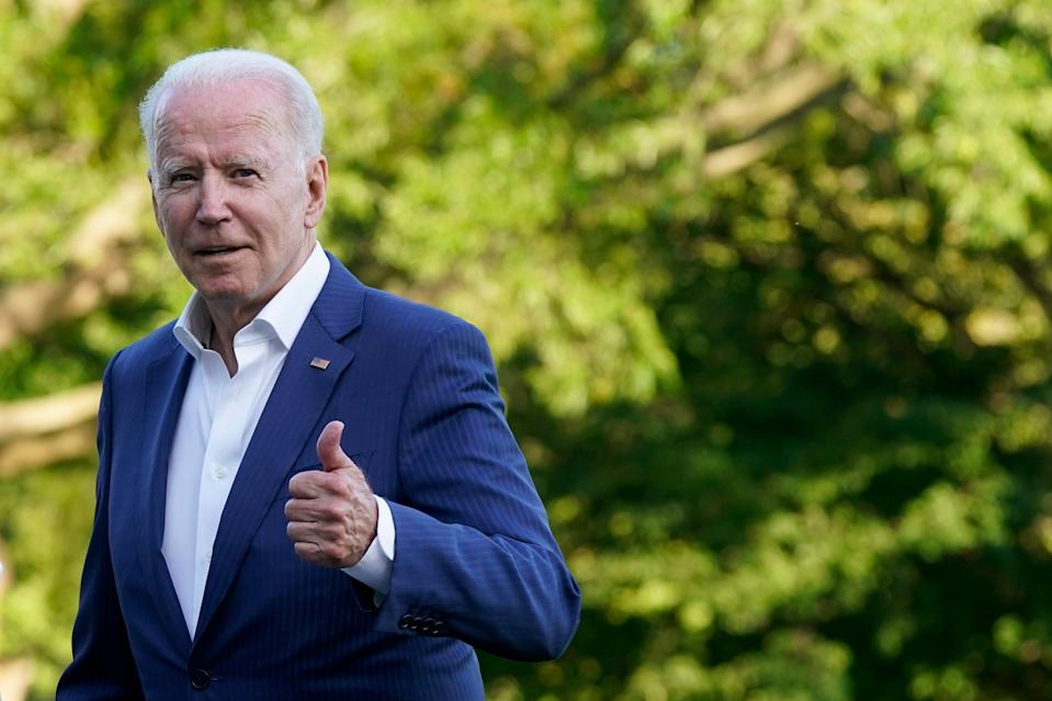President Joe Biden gestures as he walks on the South Lawn of the White House on Sunday (AP)