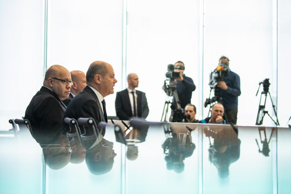 German Finance Minister Olaf Scholz (C) and German Economy Minister Peter Altmeier (L) attend a press conference to announce measures to contrast the economic consequences of the Coronavirus crise at the Bundespressekonferenz in Berlin, Germany on Marsch 13, 2020. (Photo by Emmanuele Contini/NurPhoto via Getty Images)