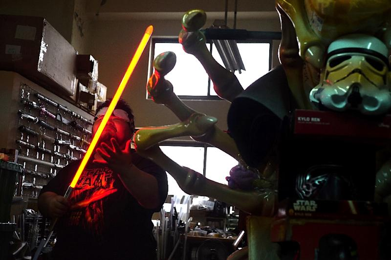 As fans gather globally on May 4th for what has become the unofficial Star Wars Day -- this year mourning the death of towering Chewbacca actor Peter Mayhew -- many will be clutching one of Makoto Tsai's lightsabers, made in his workshop near Taipei (AFP Photo/HSU Tsun-hsu)
