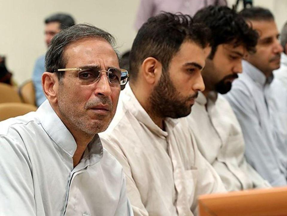 Iranian gold trader Vahid Mazloumin (left) during his trial in September on corruption charges: Reuters