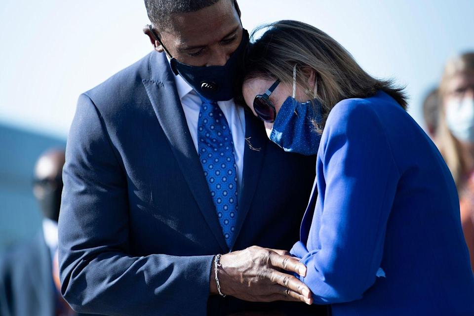 <p>House Speaker Nancy Pelosi and Michael Collins, Lewis's longtime chief of staff, shared a touching embrace as the Congressman's remains were carried out of the Capitol. Collins worked for Lewis for over 21 years. </p>