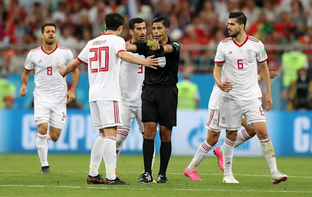 Soccer Football - World Cup - Group B - Iran vs Portugal - Mordovia Arena, Saransk, Russia - June 25, 2018 Iran's Sardar Azmoun is shown a yellow card by referee Enrique Caceres REUTERS/Ricardo Moraes