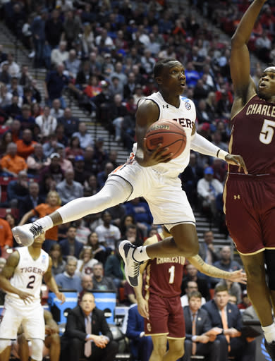 Auburn guard Jared Harper (1) shoots during the second half of a first-round NCAA college basketball tournament game against Charleston, Friday, March 16, 2018, in San Diego. (AP Photo/Denis Poroy)