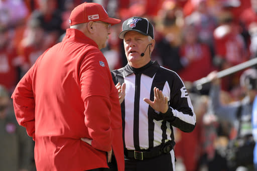 Line judge Jeff Bergman talks to Kansas City Chiefs head coach Andy Reid before an NFL football game against the Minnesota Vikings in Kansas City, Mo., Sunday, Nov. 3, 2019. (AP Photo/Reed Hoffmann)