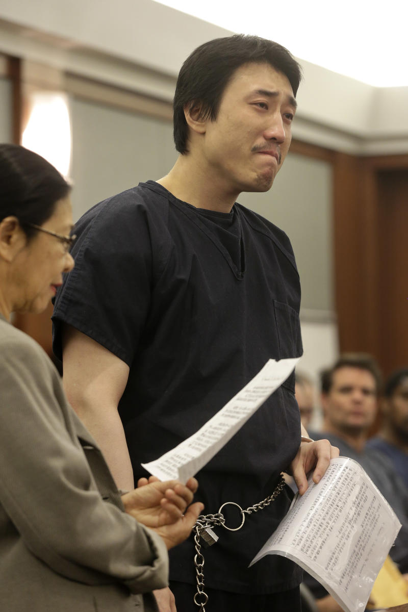 Xiao Ye Bai reads a statement to the court during his sentencing, Tuesday, March 5, 2013, in Las Vegas. The 26-year-old Chinese immigrant, convicted of being an enforcer for a Taiwan-based criminal gang, will spend the rest of his life in a Nevada prison for killing one person and wounding two others in a bloody knife attack in a Las Vegas karaoke bar in July 2009. (AP Photo/Julie Jacobson)