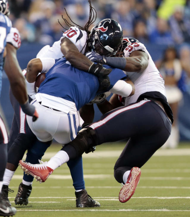 <p>Indianapolis Colts quarterback Jacoby Brissett (7) is sacked by Houston Texans' Jadeveon Clowney (90) and Joel Heath (93) during the first half of an NFL football game, Sunday, Dec. 31, 2017, in Indianapolis. (AP Photo/AJ Mast) </p>