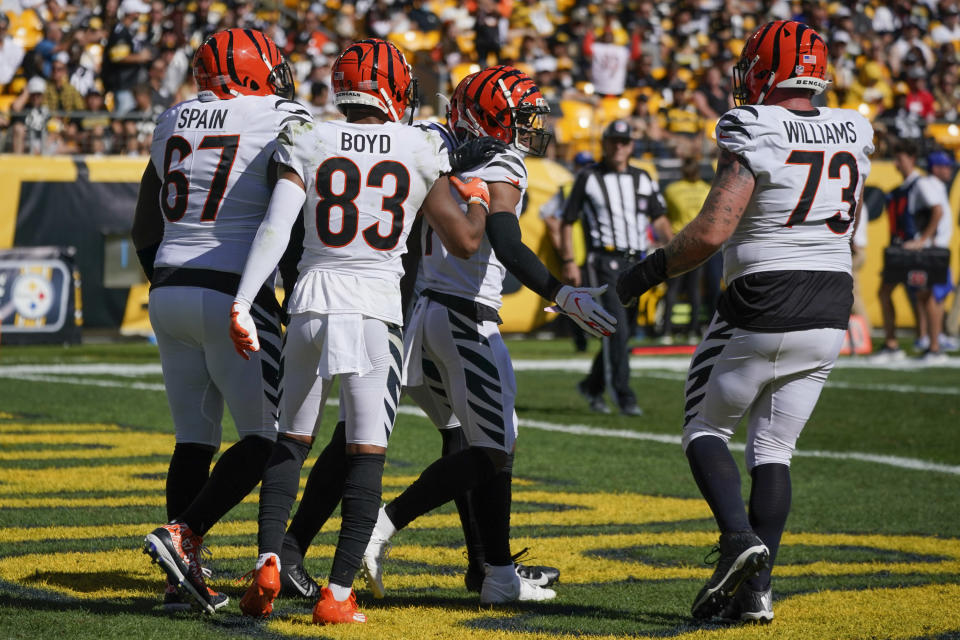 Cincinnati Bengals wide receiver Ja'Marr Chase (1) celebrates with teammates after he caught a touchdown pass against the Pittsburgh Steelers during the second half an NFL football game, Sunday, Sept. 26, 2021, in Pittsburgh. (AP Photo/Gene J. Puskar)