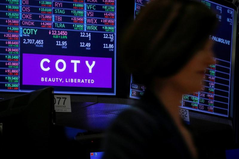 FILE PHOTO: A screen displays the logo and trading information for Coty Inc at the NYSE in New York