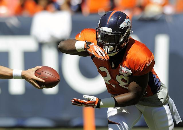 Denver Broncos running back Montee Ball takes a handoff before the start of the NFL Broncos Summer Scrimmage at Sports Authority Field at Mile High on Saturday, Aug. 2, 2014, in Denver. (AP Photo/Chris Schneider)