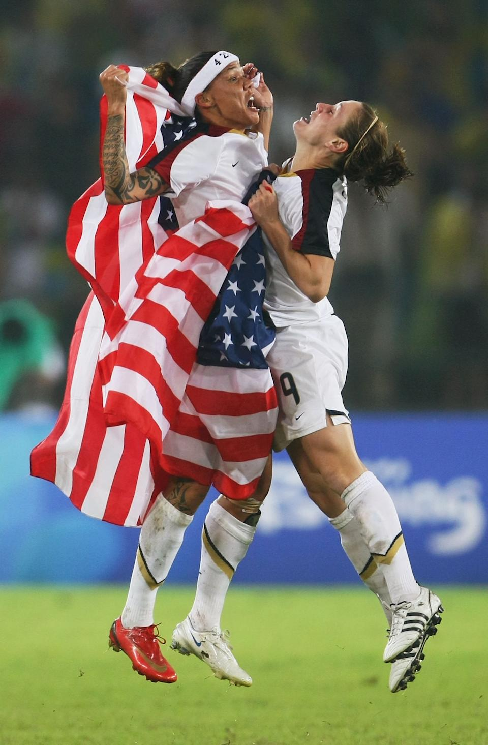 Heather O'Reilly (#9) and Natasha Kai (#6) of United States celebrate after winning the Women's Football Gold Medal match between Brazil and the United States 0-1 on Day 13 of the Beijing 2008 Olympic Games on August 21, 2008 at Worker's Stadium in Beijing, China. (Photo by Lars Baron/Bongarts/Getty Images)