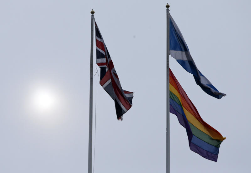 "The rainbow flag, bottom right, a symbol of the lesbian, gay, bisexual, and transgender community, flies alongside the British, left, and the Scottish flag over the British government's Scotland Office building, in central London, Friday, March 28, 2014, to mark the start of same-sex weddings in the UK from Saturday March 29, 2014. The British government has ordered rainbow flags to be flown over two prominent government buildings to mark the country's first same-sex weddings, ahead of the law taking effect on Saturday. It marks a profound shift in attitudes in a country that little more than a decade ago had a law on the books banning the ""promotion"" of homosexuality. (AP Photo/Lefteris Pitarakis)"