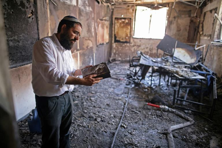 A Rabbi inspects the damage inside a torched religious school in the central Israeli city of Lod, near Tel Aviv, on May 11