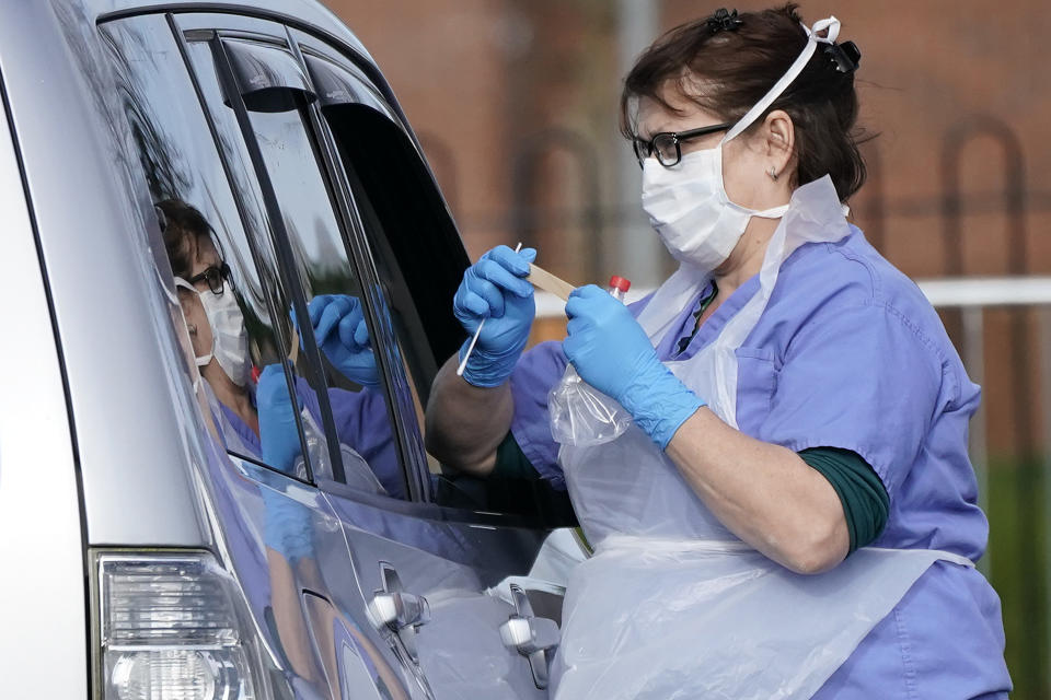 WOLVERHAMPTON, ENGLAND - MARCH 12:  A member of the public is swabbed at a drive through Coronavirus testing site, set up in a car park, on March 12, 2020 in Wolverhampton, England. The National Health Service facility has been set up in a car park to allow people with NHS referrals to be swabbed for Covid-19.  (Photo by Christopher Furlong/Getty Images)