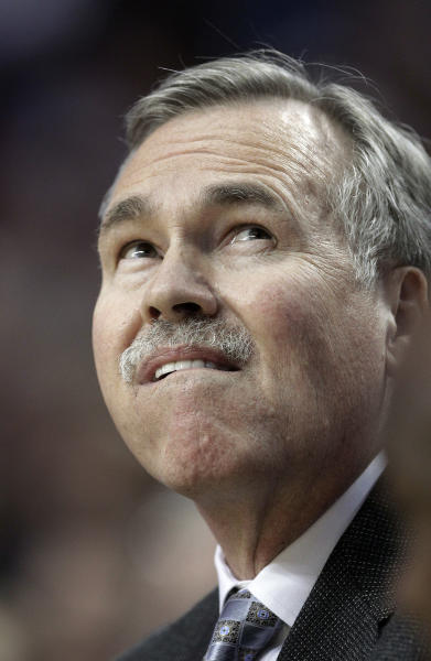 Los Angeles Lakers coach Mike D'Antoni looks up at the scoreboard during the first quarter of an NBA basketball game against the Portland Trail Blazers in Portland, Ore., Wednesday, April 10, 2013. (AP Photo/Don Ryan)