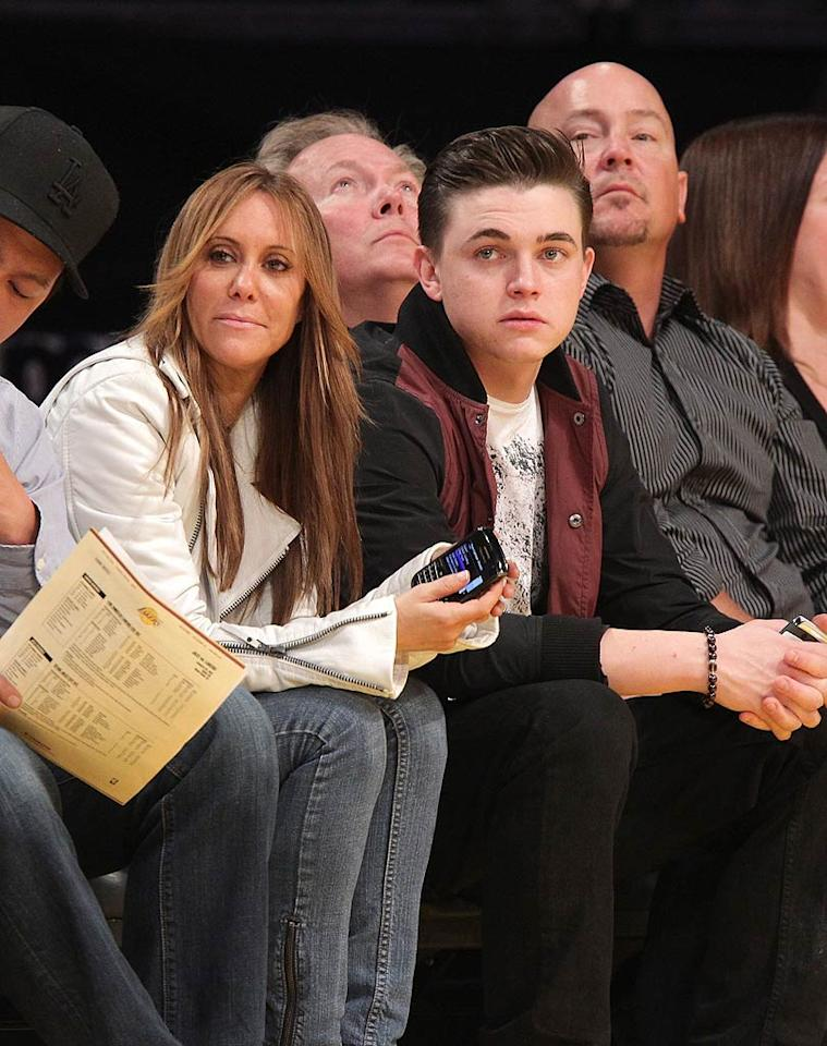 "Baby-faced singer Jesse McCartney -- who performed the National Anthem at a Phoenix Suns game in October -- looked rather serious while sitting courtside. Noel Vasquez/<a href=""http://www.gettyimages.com/"" target=""new"">GettyImages.com</a> - January 25, 2011"