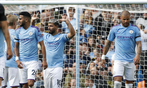 Manchester City's Bernardo Silva, center, celebrates after scoring his second goal during the English Premier League soccer match between Manchester City and Brighton & Hove Albion at Etihad stadium in Manchester, England, Saturday, Aug. 31, 2019. (AP Photo/Rui Vieira)