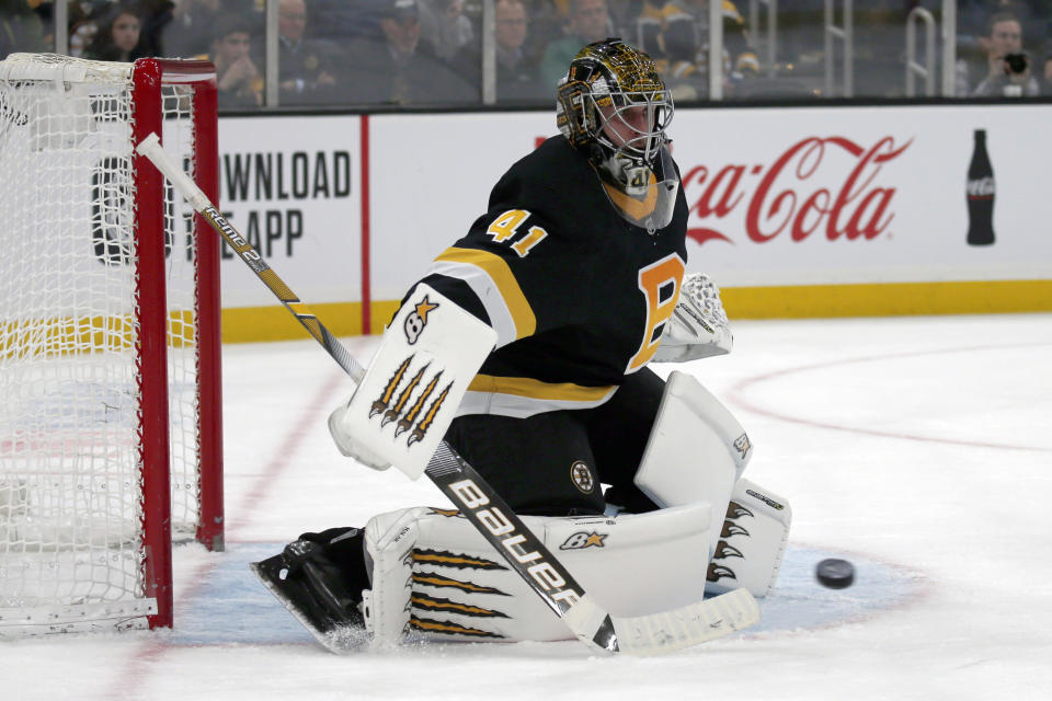 Boston Bruins goaltender Jaroslav Halak (41) makes a pad save during the third period of an NHL hockey game against the Pittsburgh Penguins, Thursday, Jan. 16, 2020, in Boston. (AP Photo/Mary Schwalm)