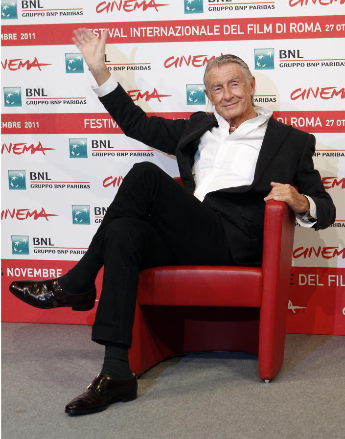 FILE - In this Nov. 3, 2011 file photo, director Joel Schumacher waves during a photo call for Cinema and Advertising: Joel Schumacher directs Campari, at the Rome International Film Festival. A representative for Schumacher said the filmmaker died Monday, June 22, 2020, in New York after a year-long battle with cancer. He was 80. (AP Photo/Pier Paolo Cito, File)