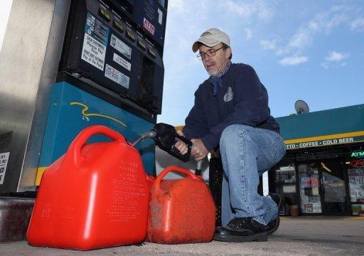 A New York man pumps gas into containers