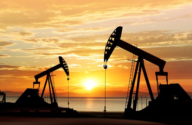 Oil pumps silhouetted against a sunset.