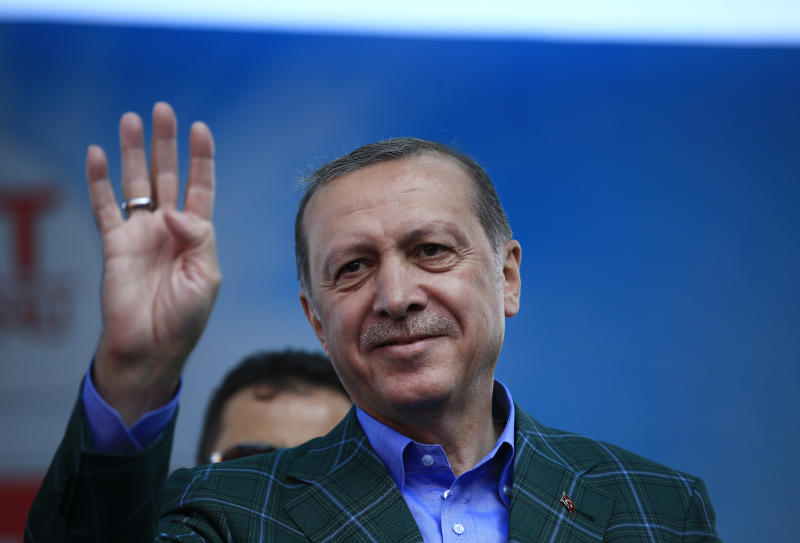 FILE - In this Saturday, April 15, 2017 photo, Turkey's President Recep Tayyip Erdogan waves to supporters during the last rally ahead of Sunday's referendum, in Istanbul. Few men can claim to have dominated politics in Turkey - or polarized his people - as much as Erdogan, the 63-year-old president who has urged his nation to approve reforms that will greatly expand his powers. (AP Photo/Lefteris Pitarakis, file)
