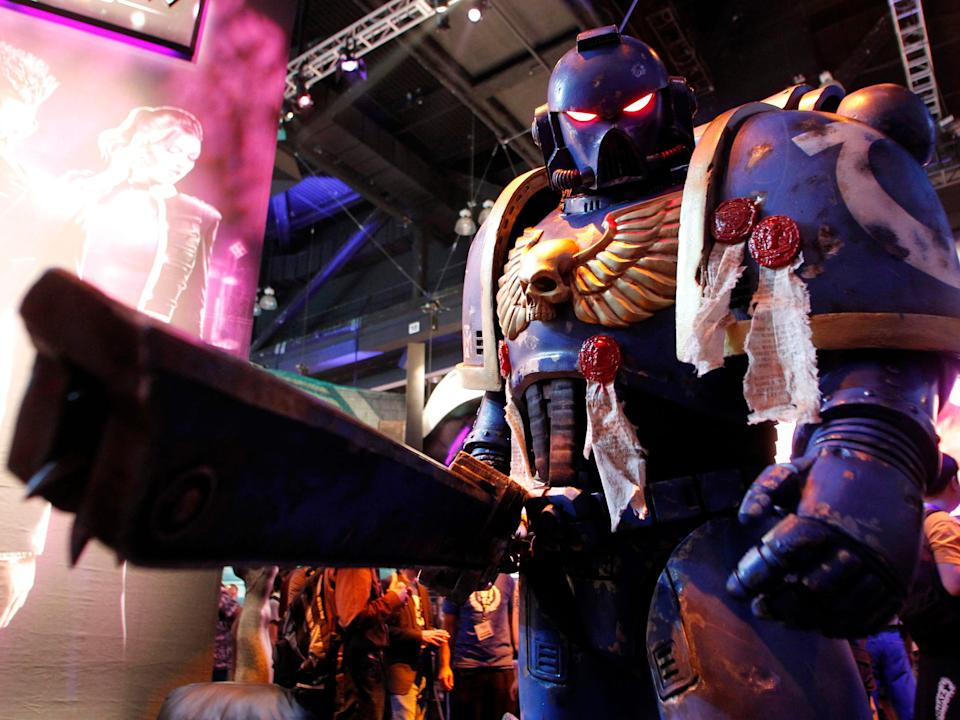 """A person dressed up as a space marine from the popular fantasy game """"Warhammer."""""""
