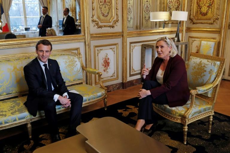 Most analysts see the two-round election process heading to a repeat of the 2017 final-stage duel between Macron and far-right leader Marine Le Pen (AFP/PHILIPPE WOJAZER)