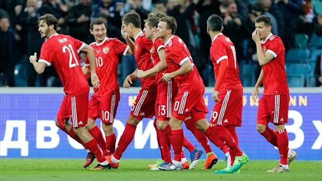 Christian Benteke scored twice but Belgium were denied victory by Aleksandr Bukharov's late strike for Russia in a 3-3 draw.