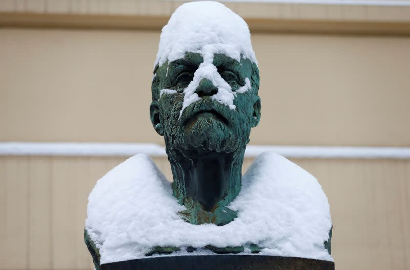 FILE PHOTO: Snow is piled on the bust of Alfred Nobel outside the Norwegian Nobel Institute in Oslo