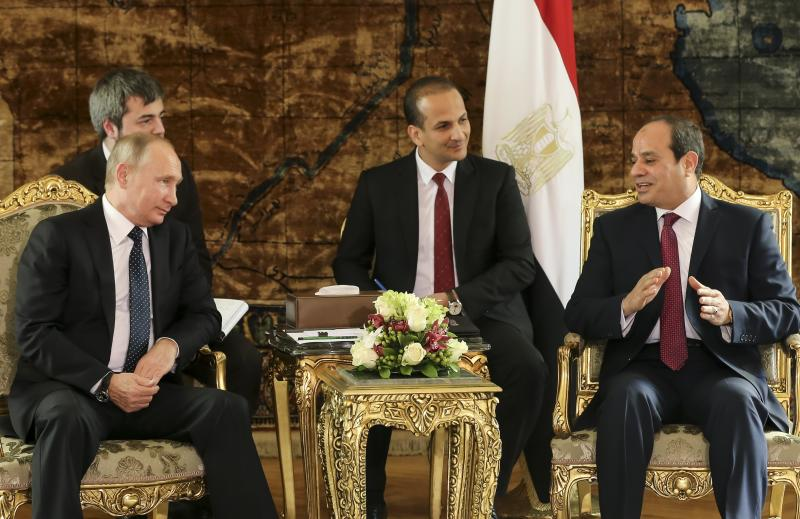 FILE - In this Dec. 11, 2017 file photo, Russian President Vladimir Putin, left, listens to Egyptian President Abdel-Fattah El-Sissi, during their meeting in Cairo, Egypt. Russia's transportation minister said Friday, Dec. 15, 2017 flights between Moscow and the Egyptian capital of Cairo are to resume in February after a two-year hiatus. Moscow suspended flights to Egypt after an Islamic State bomb brought down a Russian airliner over Sinai in October 2015, killing all 224 people on board. (AP Photo/Alexander Zemlianichenko, pool, File)